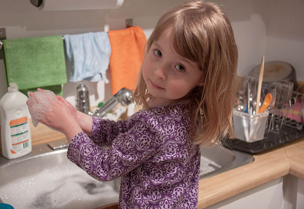 Cleaning tips - Girl Doing Dishes